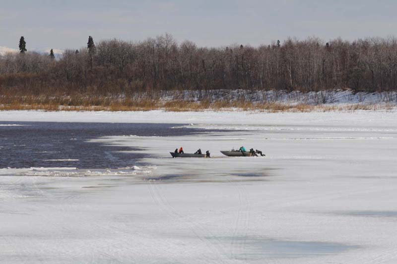 People launching boats at FAA in preparation of heading up the Aniak River for some ducks and geese.
