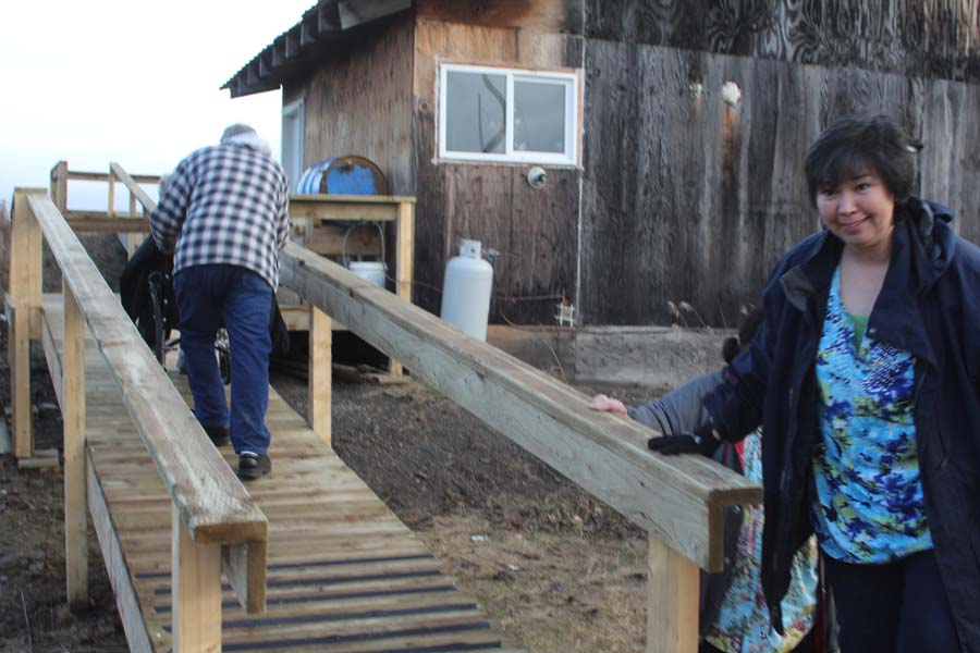 Joe pushing Dee up the ramp built by Morgan Adkins, Bruce Richardson and numerous high school students.