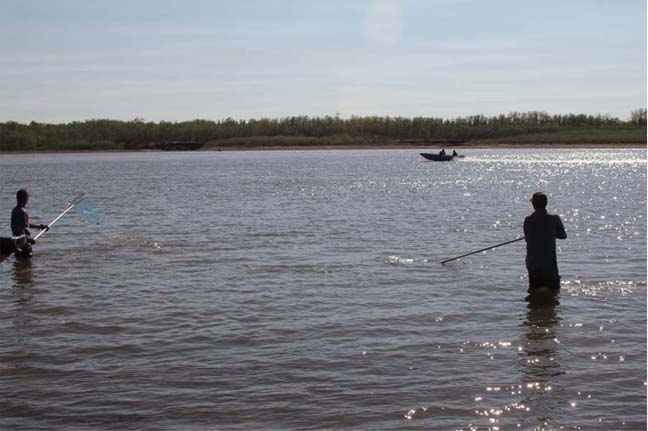 Fishermen plying the water on a gorgeous day in Kalskag.
