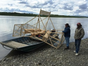 Project Leader Nathan Underwood (L) and assistant Tommy Tom on their way to Sleetmute with the first fish wheel of the NVN Middle Kuskokwim Fish Wheel Project