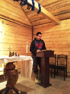 Ben Leary reads the Christmas Story from the Bible during the Christmas Eve service