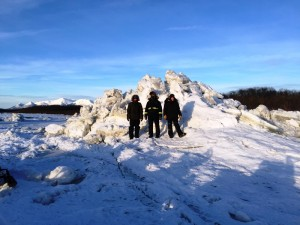 mountain of ice near the upper mouth of the Kolmokofsky River. L-R: Kory Morrow, Dakota Phillips, Megan Leary
