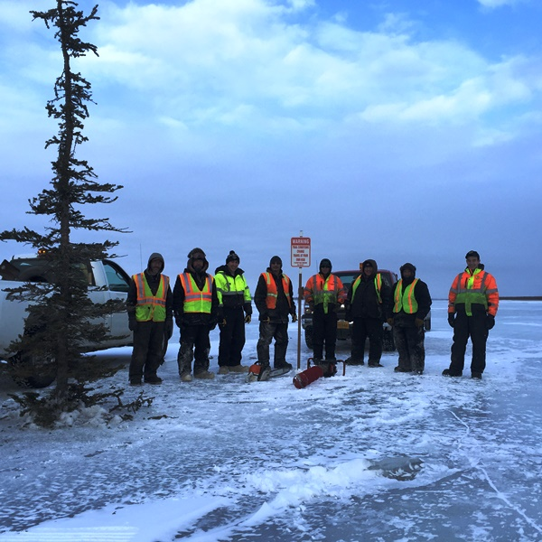 Lower Kalskag, Napaimute, & Crow Village Crew at Mile Post 0 of Upriver Route 1 near the mouth of the Tuluksak River L-R: Joe Simeon, Ludwig White, Ben Leary, Andrew Kameroff, Jr., Nikolai Savage, Mike Evan, Jr., Nick Levi, & Dakota Phillips